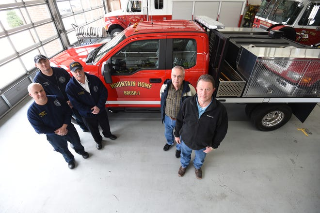 Mountain Home firefighters  (from left) Chris Hall, Lt. Bob Harris and Chief Ken Williams were joined Friday by city council member Wayne Almond and Mayor Hillrey Adams at Station 1 as the city officials checked out the departments new brush truck.