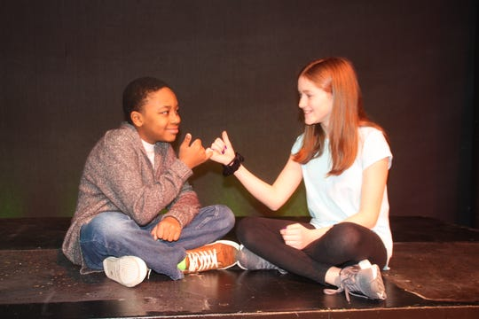 "Jayjay (Macellus Brown) makes a pact with his friend Grace (Jadelyn Joeley Anderson) in a scene from ""John Henry"" by Elise Forier Edie, which debuts Feb. 8 at The Growing Stage."