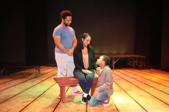 """John Henry (Steven Michael Martin) looks with pride on his wife, Polly Ann (Natalie Marie Bailey), and his son, Jayjay (Macellus Brown), in """"John Henry"""" by Elise Forier Edie."""