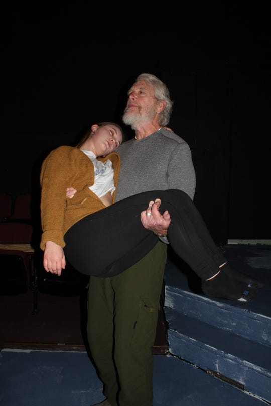 """Lear (Christopher Gibbs) cradles his beloved daughter Cordelia (Madelyn Barkocy) in this rehearsal of the climax of """"King Lear."""""""