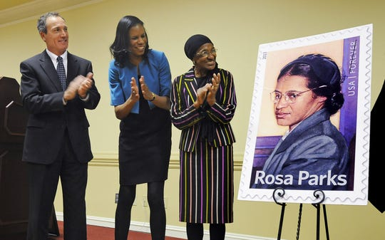 This 2013 file photo shows, from left, Montgomery postmaster Donald Snipes,  keynote speaker Riche' Richardson and director of the Rosa Parks Museum Georgette Norman during the unveiling of the new Rosa Parks postage stamp at a celebration of the 100th birthday of Rosa Parks at Troy University's Montgomery campus.