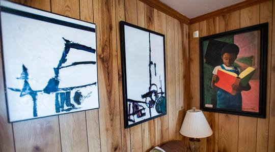 The painting at right is the lone Fishoe painting in the home of John Feagin in Montgomery, Ala., on Friday February 1, 2019.