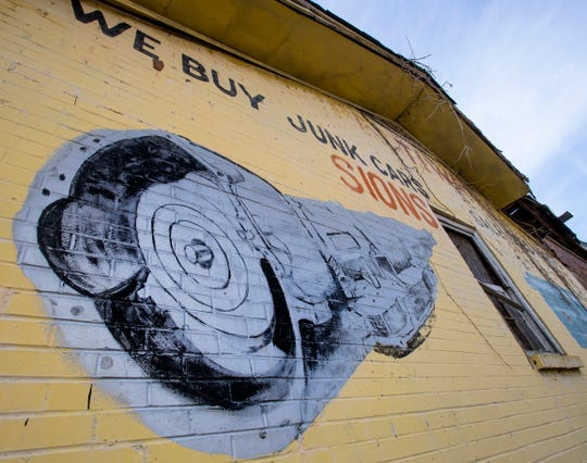 Paintings of transmissions and mufflers painted by artist Fishoe are still on the Pettiway Transmission shop in Montgomery, Ala., on Friday February 1, 2019.