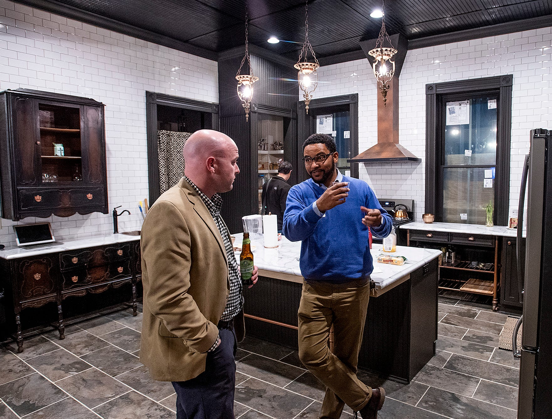 Justin Hampton chats in the kitchen of his home on Goldthwaite St. in Montgomery, Ala., as it is opened for a Landmarks Foundation Renovators Open House on Thursday evening January 31, 2019.