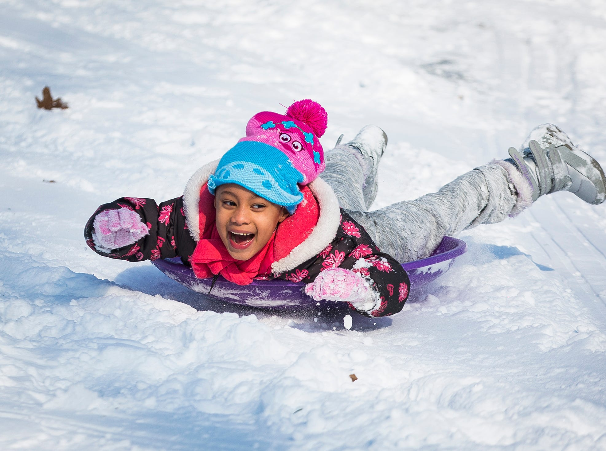 After days of intense cold, snow day makes Friday perfect for sledding