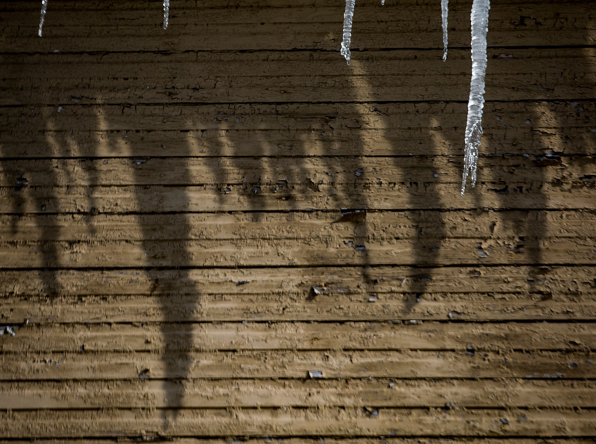 Icicles cast a shadow on a downtown Muncie home Friday.