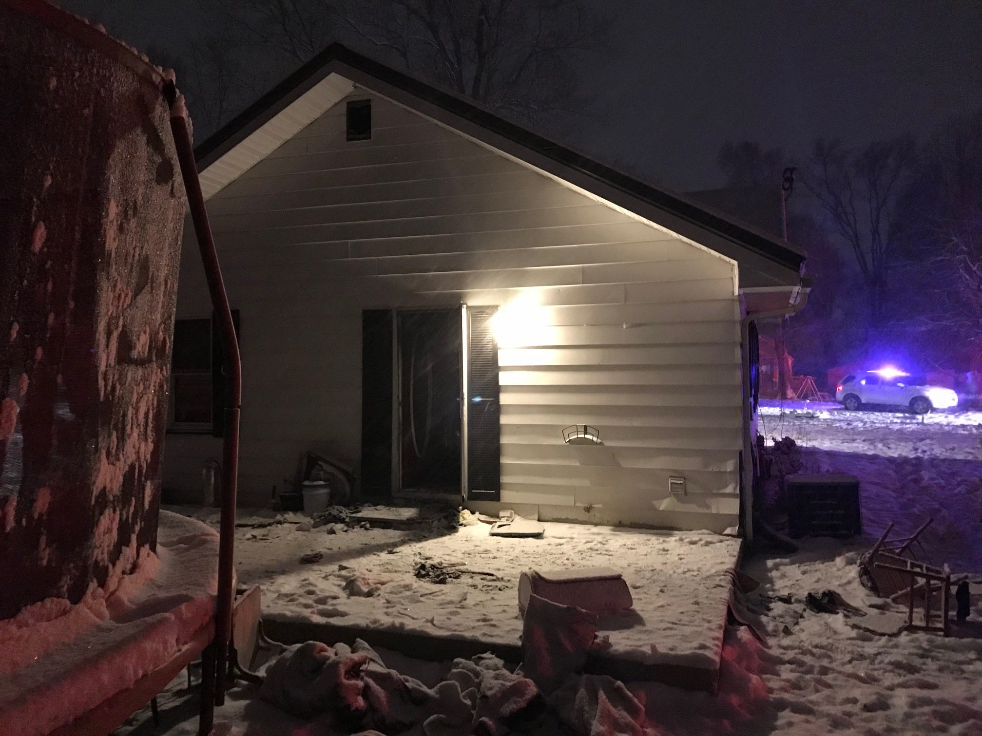 Volunteer firefighters late Thursday contended with snow accumulating on frozen roads when called to a house fire along Stick City Road in Monroe Township.