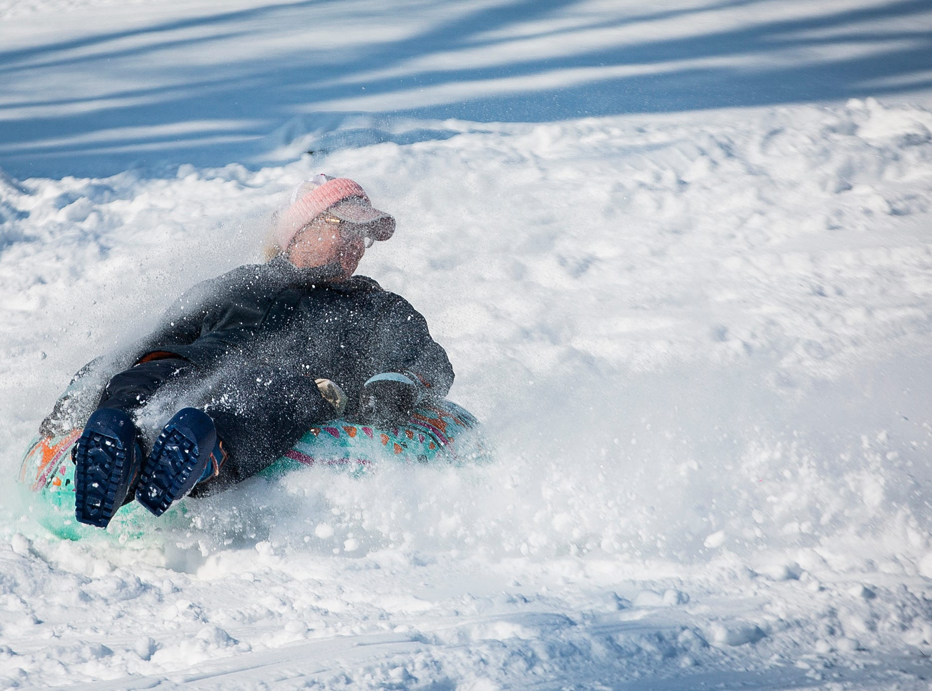Locals take advantage of warmer temperatures and snow left by Thursday night's snow storm at McCulloch Park Friday afternoon.