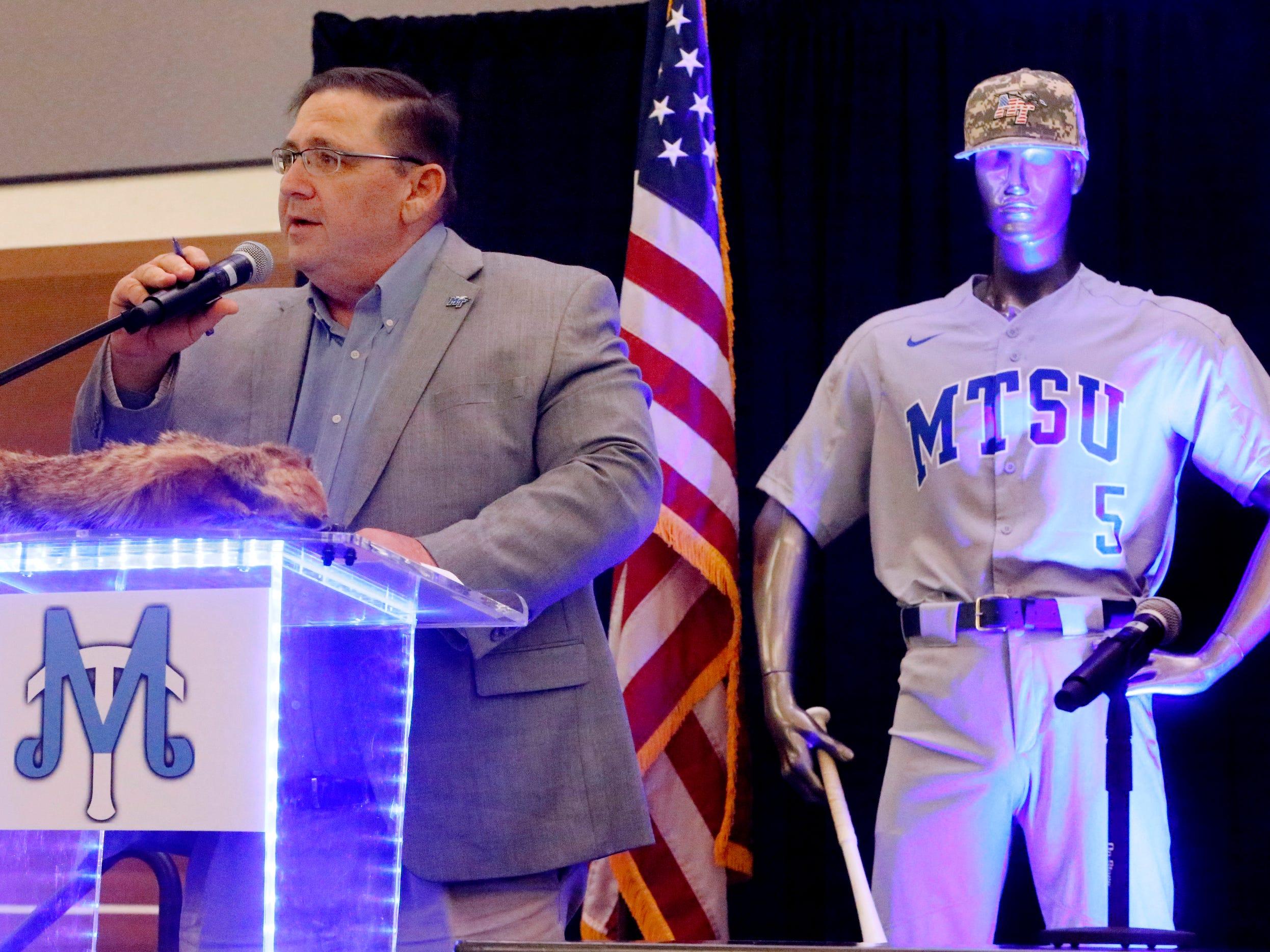 MTSU's new baseball coach Jim Toman, left, talks to the crowd on Friday, Feb. 1, 2019, at the annual MTSU baseball kickoff Groundhog Day Luncheon.