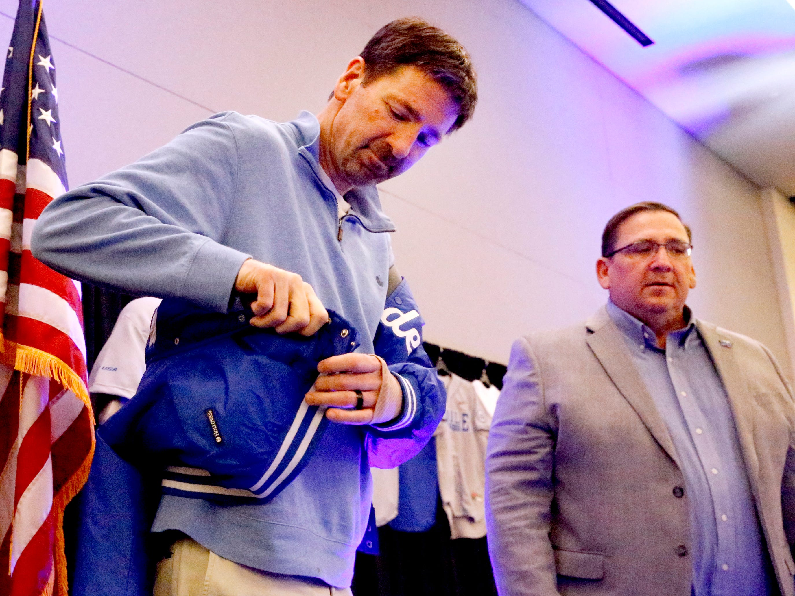 George Zimmerman puts on his Railbird coat after MTSU's new baseball coach Jim Toman, names Zimmerman as this year's Railbird on Friday, Feb. 1, 2019, during the annual Groundhog Day luncheon.