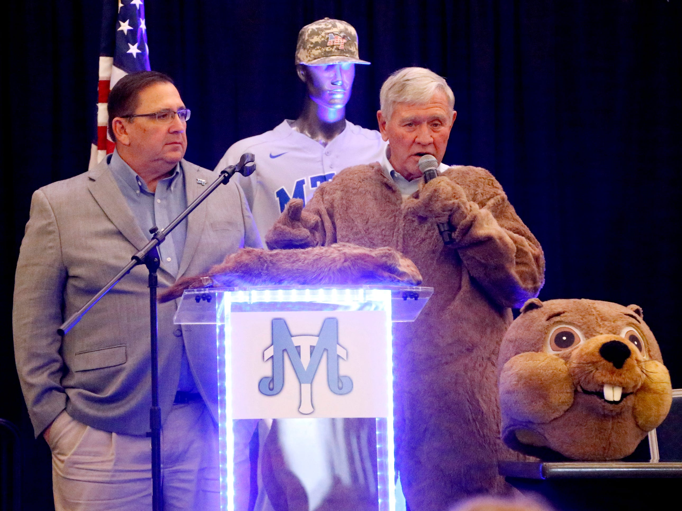 MTSU's new baseball coach Jim Toman, left,  stands with former MTSU baseball Coach Steve Peterson, who dressed as Raider 3  during this years annual Groundhog Day luncheon.