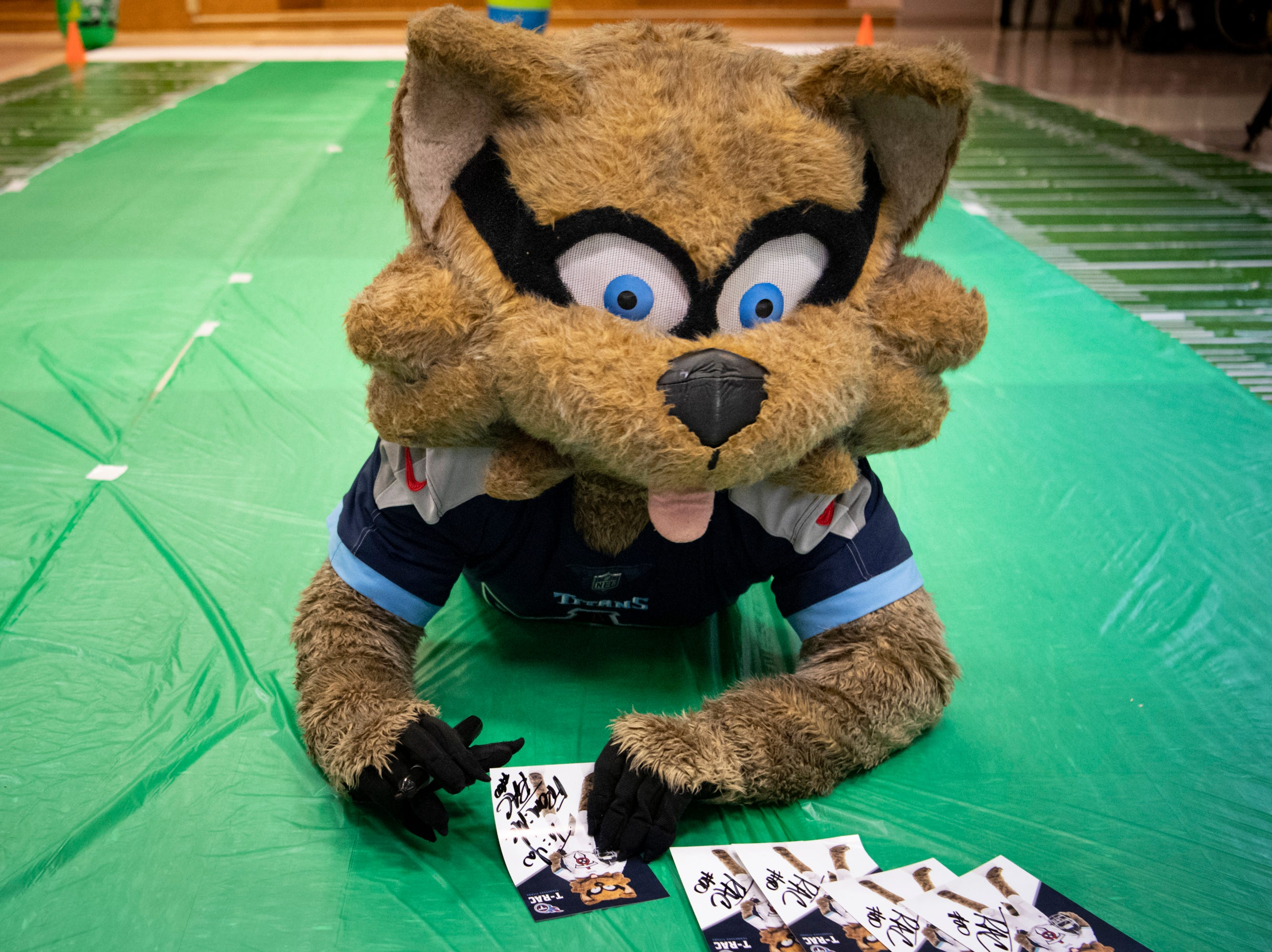 The Titans mascot T-Rac signs autographs before the Wheelchair Super Bowl at Nashville Community Care and Rehabilitation at Bordeaux in Nashville, Tenn., Friday, Feb. 1, 2019.