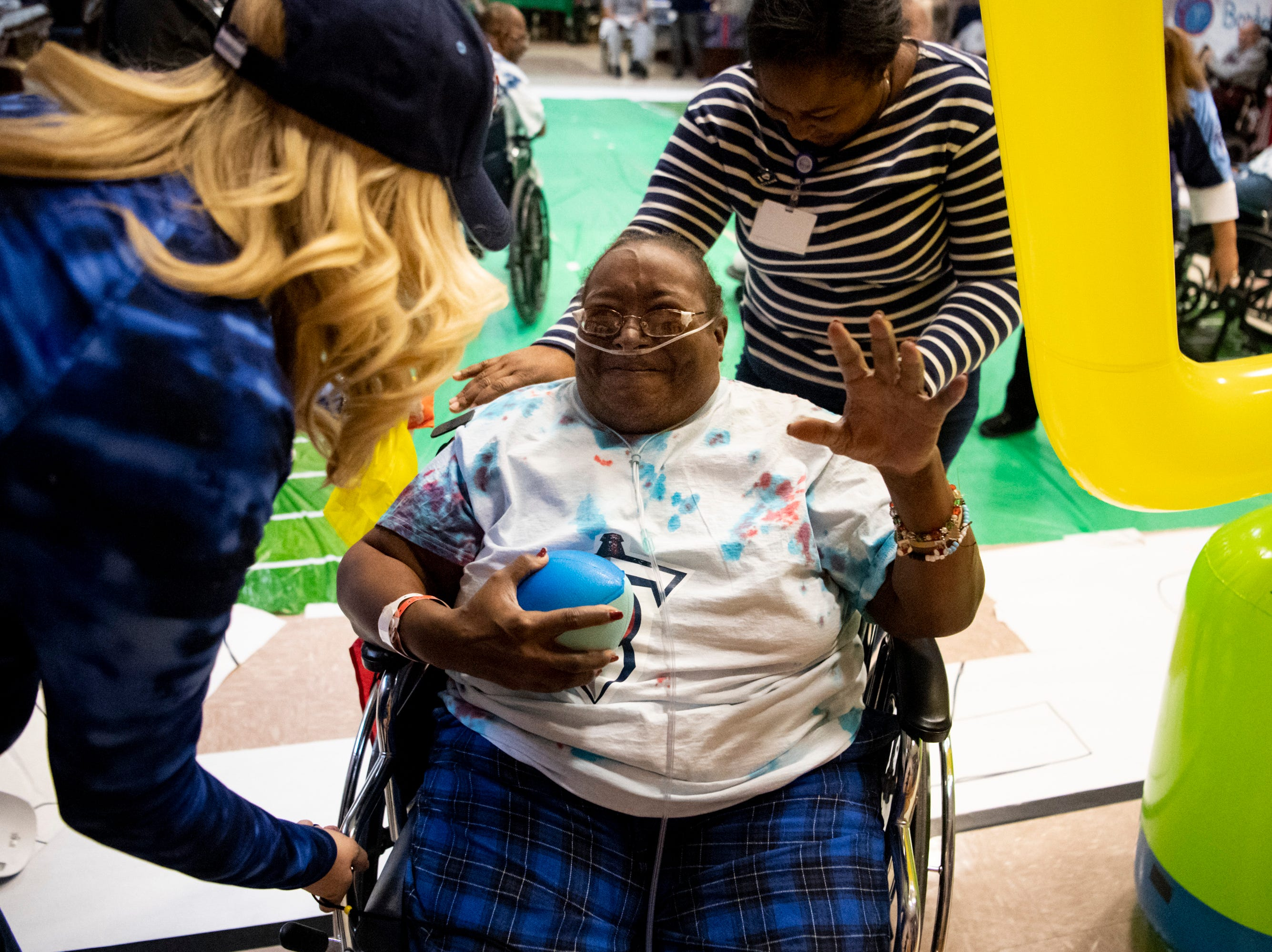 Molisha McCord reacts after scoring a touchdown during the Wheelchair Super Bowl at Nashville Community Care and Rehabilitation at Bordeaux in Nashville, Tenn., Friday, Feb. 1, 2019.
