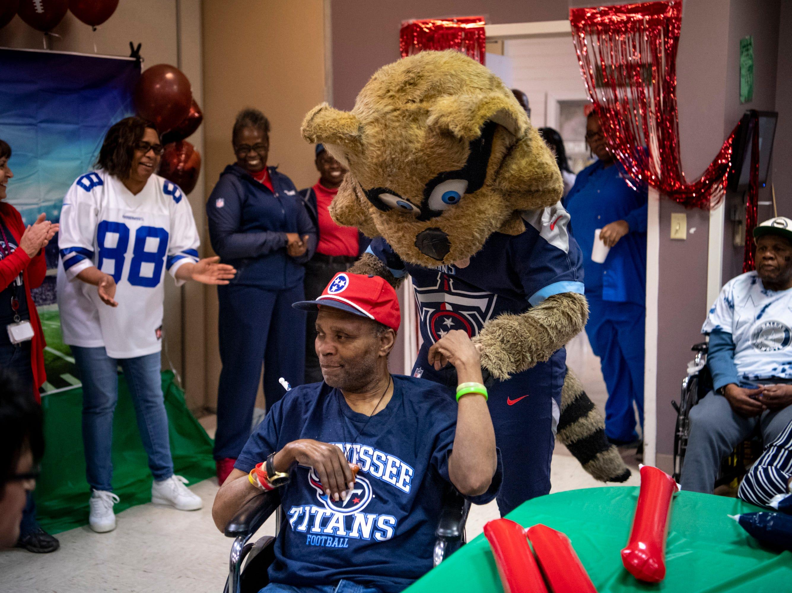 The Titans mascot T-Rac greets Sam Sims before the Wheelchair Super Bowl at Nashville Community Care and Rehabilitation at Bordeaux in Nashville, Tenn., Friday, Feb. 1, 2019.