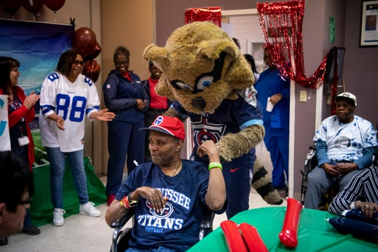 The Titans mascot T-Rac greets Sam Sims before the Wheelchair Super Bowl at Nashville Community Care and Rehabilitation at Bordeaux in Nashville, Tenn., Friday, Feb. 1, 2019.