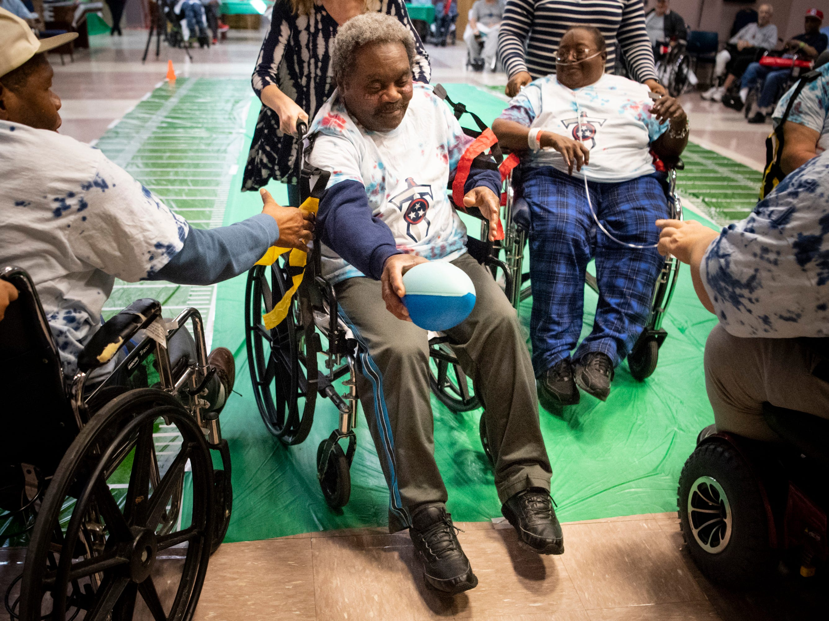 James Guest scores a touchdown during the Wheelchair Super Bowl at Nashville Community Care and Rehabilitation at Bordeaux in Nashville, Tenn., Friday, Feb. 1, 2019.