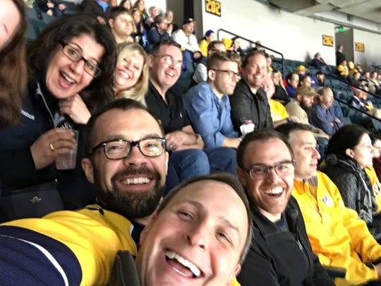 Predators supporters enjoy the game at a past Pride Night.