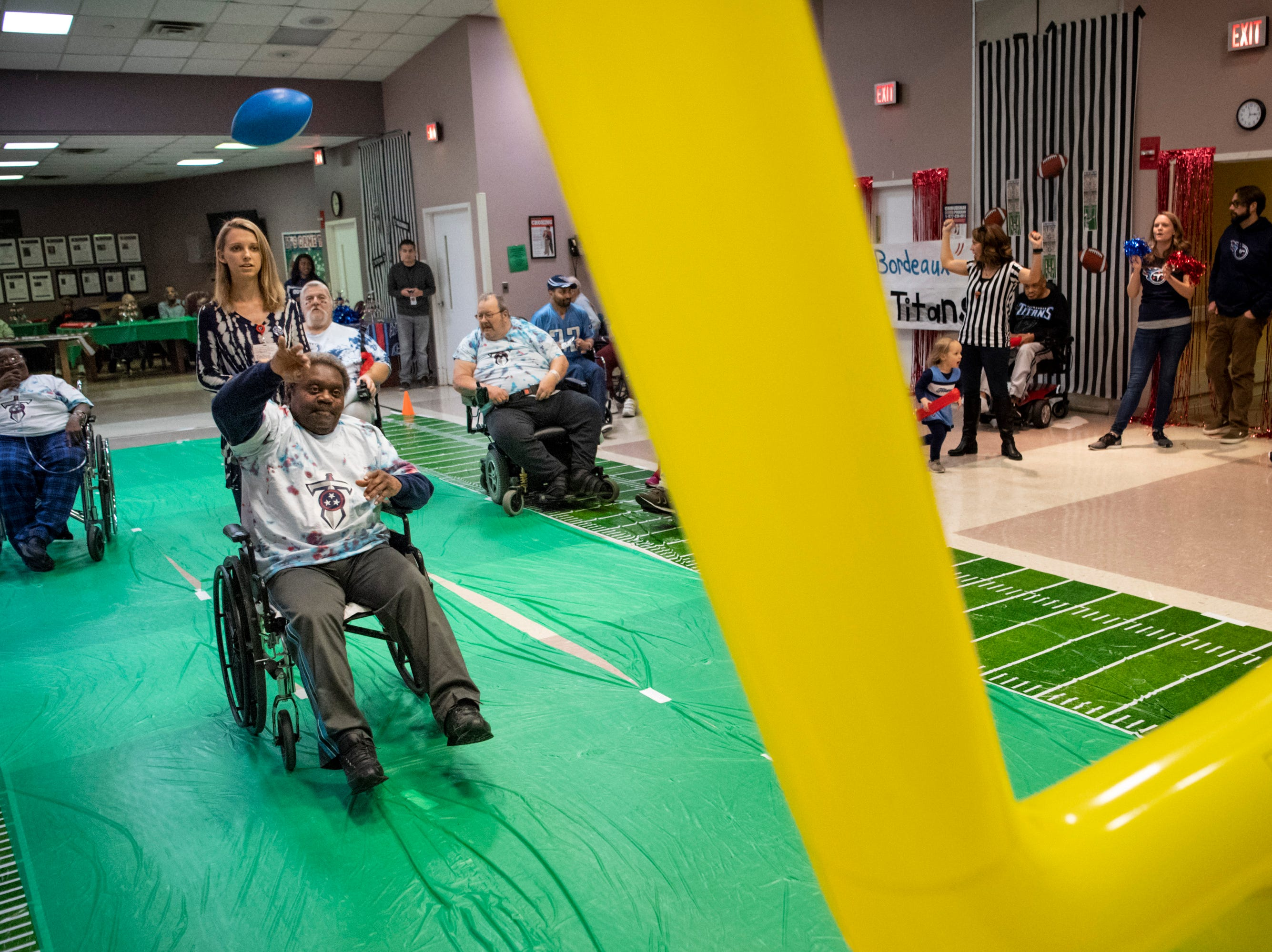 James Guest throws in a field goal during the Wheelchair Super Bowl at Nashville Community Care and Rehabilitation at Bordeaux in Nashville, Tenn., Friday, Feb. 1, 2019.