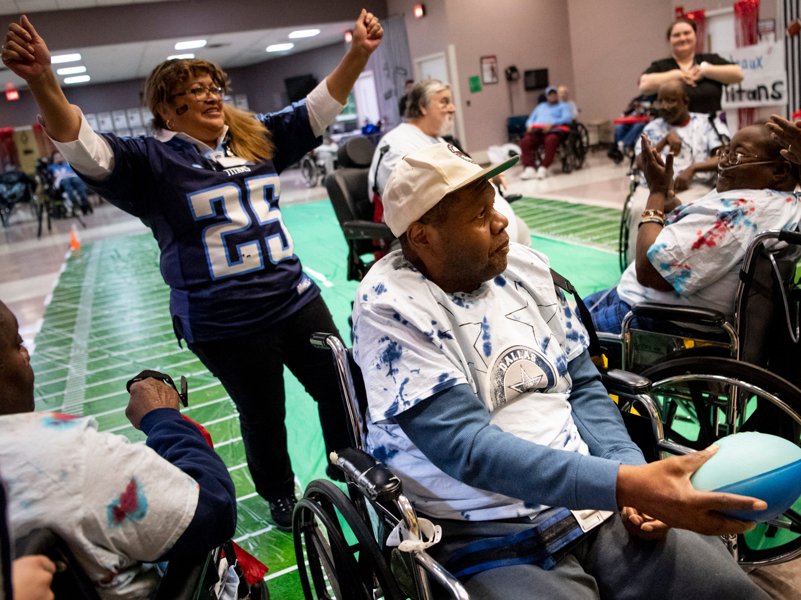 Nevel Blakemore scores a touchdown during the Wheelchair Super Bowl at Nashville Community Care and Rehabilitation at Bordeaux in Nashville, Tenn., Friday, Feb. 1, 2019.