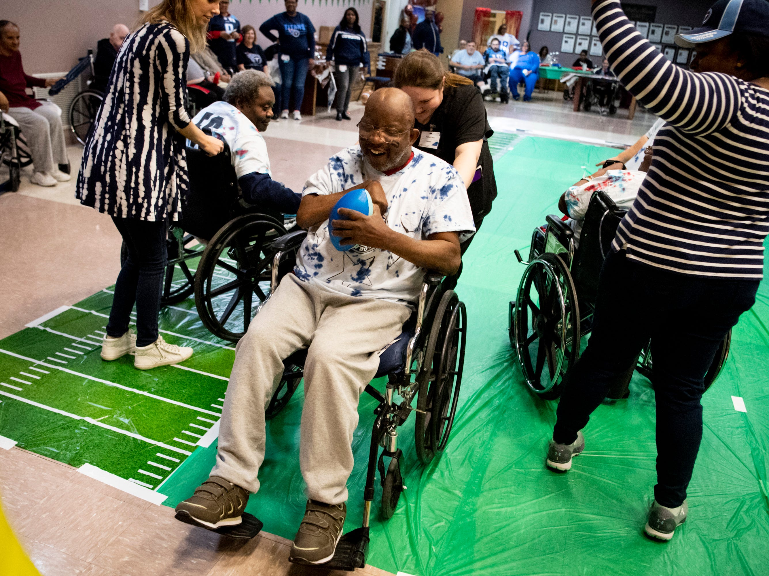 Robert Neil smiles as he approaches the end-zone during the Wheelchair Super Bowl at Nashville Community Care and Rehabilitation at Bordeaux in Nashville, Tenn., Friday, Feb. 1, 2019.