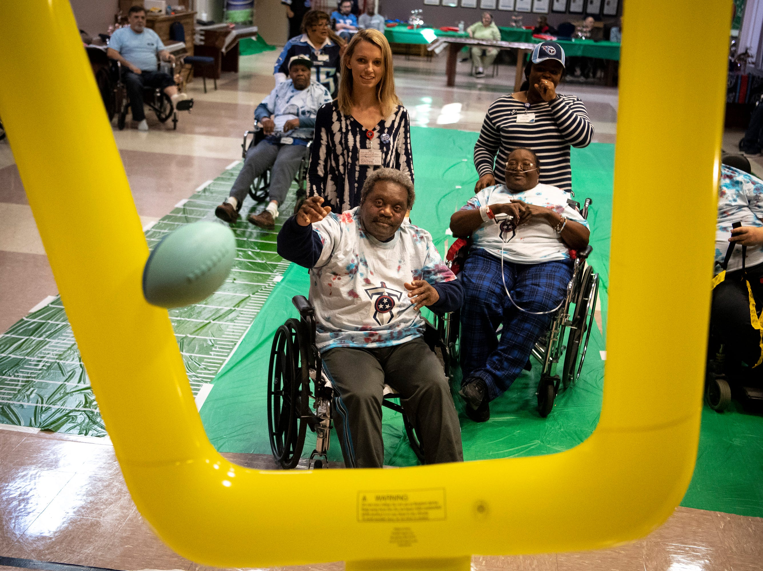 James Guest, center, throws in a field goal during the Wheelchair Super Bowl at Nashville Community Care and Rehabilitation at Bordeaux in Nashville, Tenn., Friday, Feb. 1, 2019.