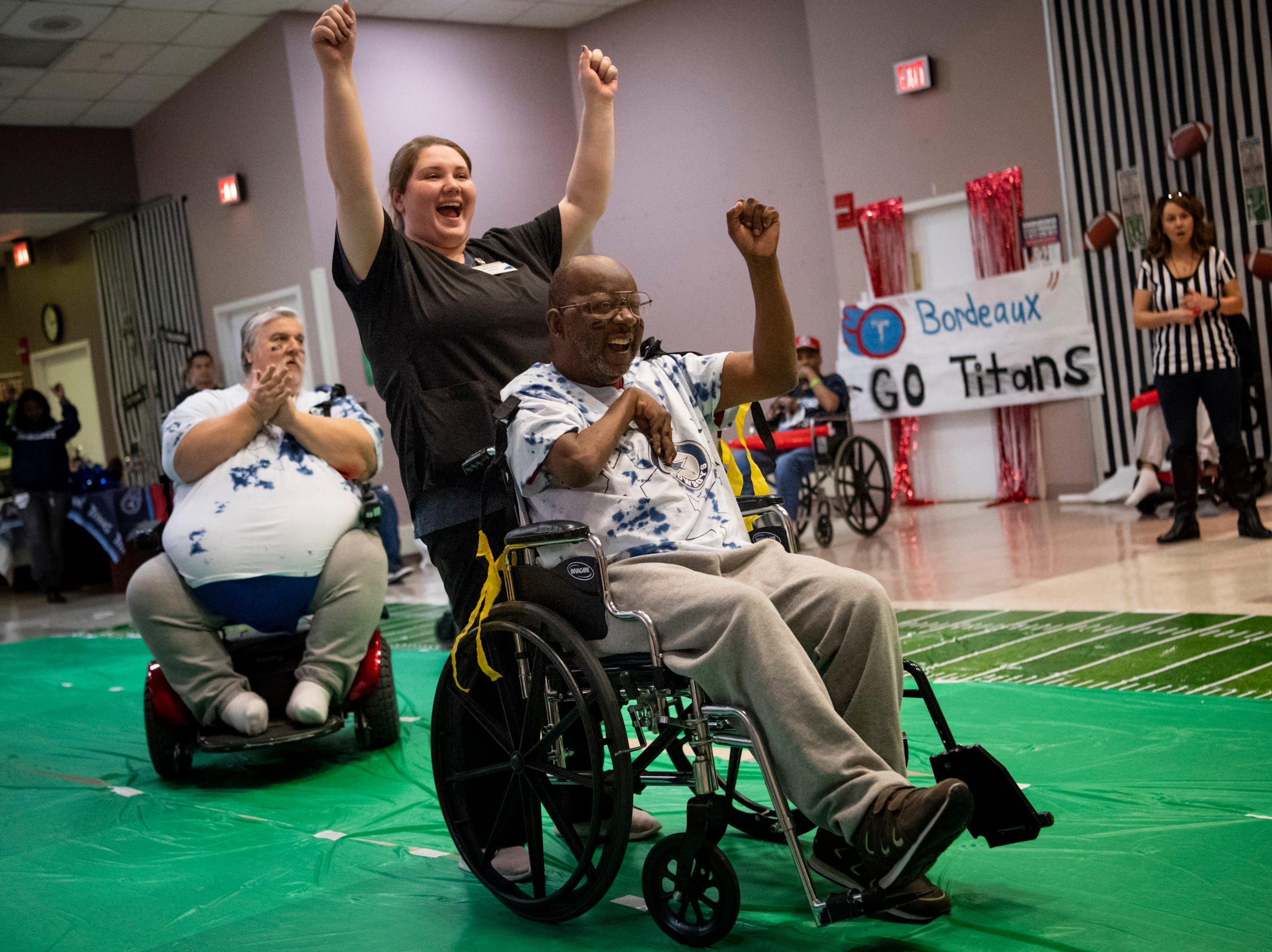 Robert McNeil celebrates scoring a field-goal during the Wheelchair Super Bowl at Nashville Community Care and Rehabilitation at Bordeaux in Nashville, Tenn., Friday, Feb. 1, 2019.