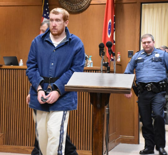 Joseph Daniels enters Dickson County Circuit Court on Friday morning for a hearing.