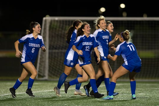 Barron Collier High School celebrates its goal in a 1-0 victory over Naples in the Class 3A-District 14 championship on Thursday.