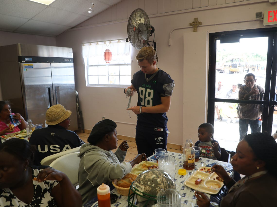 The third annual super bowl tailgating meal at the Our Lady of Guadalupe Catholic Church in the Casa Maria Soup Kitchen was held in Immokalee on Friday 2/1/2019. Coaches and players from Ave Maria University football team cooked and served meals along with interacting with clients.