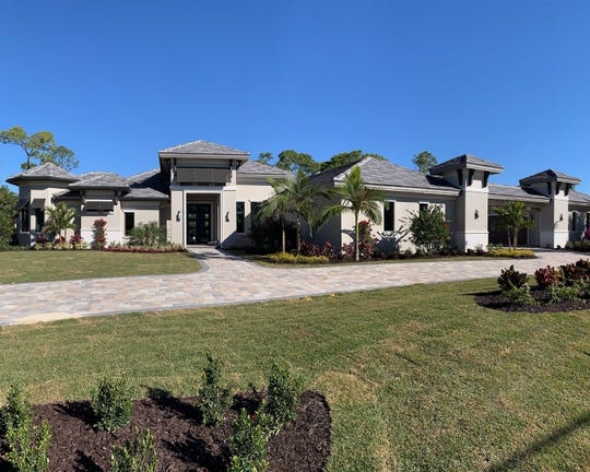 The new estate home by Florida Lifestyle Homes in the Pine Ridge neighborhood of Naples.