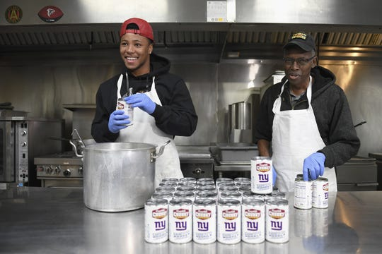 ATLANTA, GA - FEBRUARY 01: NY Giants' Saquon Barkley and Campbell's Chunky Soup Partner to Donate 100,000 Bowls of Soup to Atlanta Community Ahead of Super Bowl LIII at Crossroads Community Ministries on February 1, 2019 in Atlanta, Georgia.