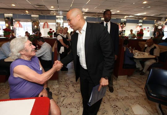 Cory Booker campaigning in 2013 for a special election to fill Frank Lautenberg's Senate seat.