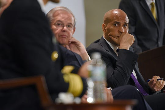 00021192A --- Livingston  -- Monday, August 8, 2016 -- NJ Senator Cory Booker, far right, and Senator Bob Menendez, R-L were part of a panel of speakers during a forum on Heroin and Opioid Addiction Crisis held at St. Barnabas Medical Center on Monday. Also on the panel were U.S. Surgeon General, Dr. Vivek Murthy and VA Under Secretary for Health, Dr. David Shulkin.