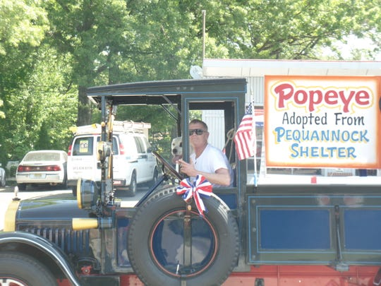 Freudenberg and Popeye ride in a 1928 truck, manufactured by White Motor Co., which he had fully restored.