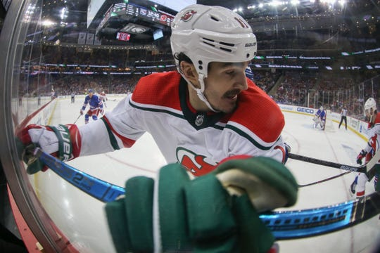 Jan 31, 2019; Newark, NJ, USA; New Jersey Devils center Brian Boyle (11) gets hit into the boards during the second period of their game against the New York Rangers at Prudential Center.