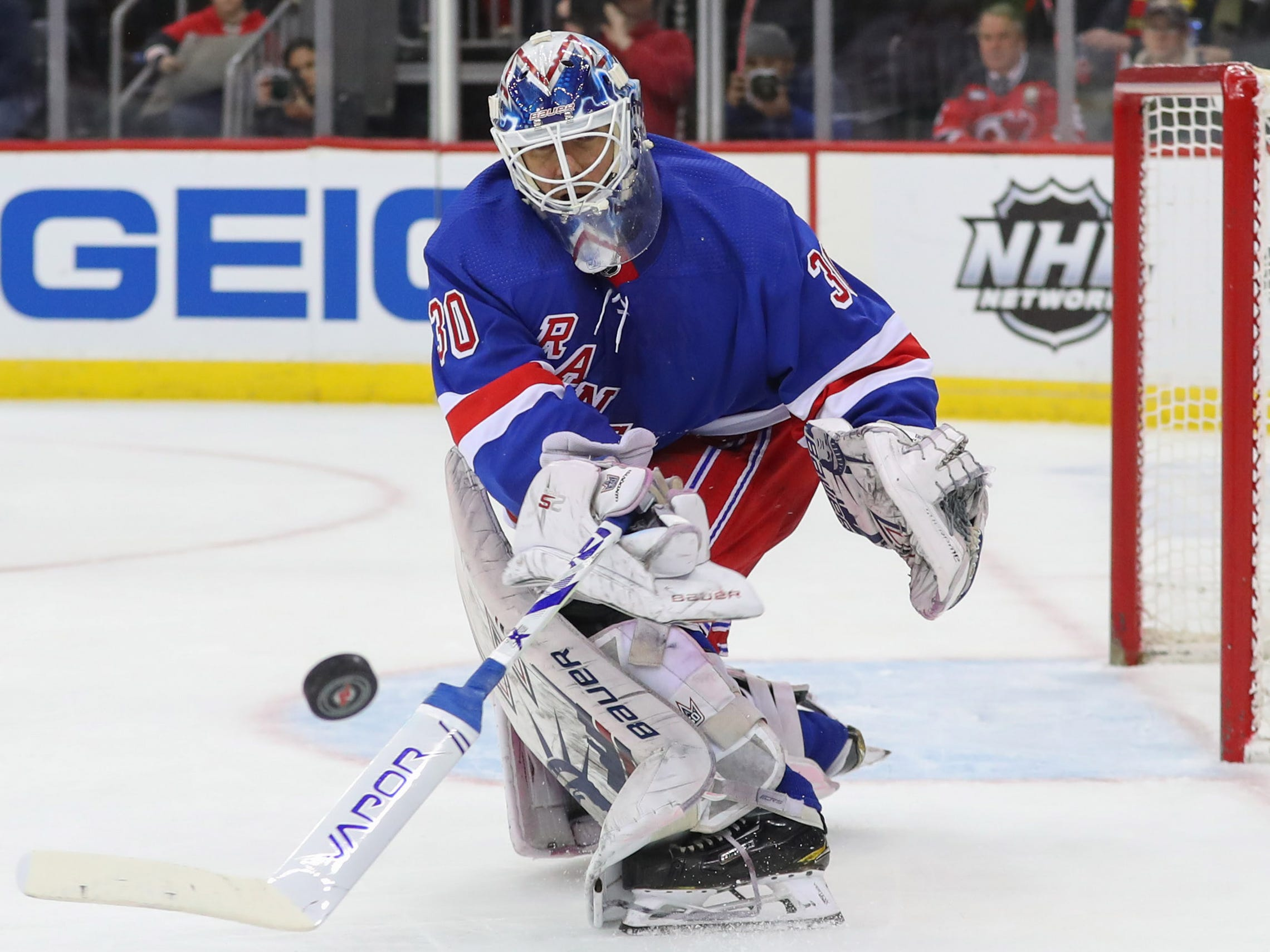 Jan 31, 2019; Newark, NJ, USA; New York Rangers goaltender Henrik Lundqvist (30) plays the puck during the second period of their game against the New Jersey Devils at Prudential Center.