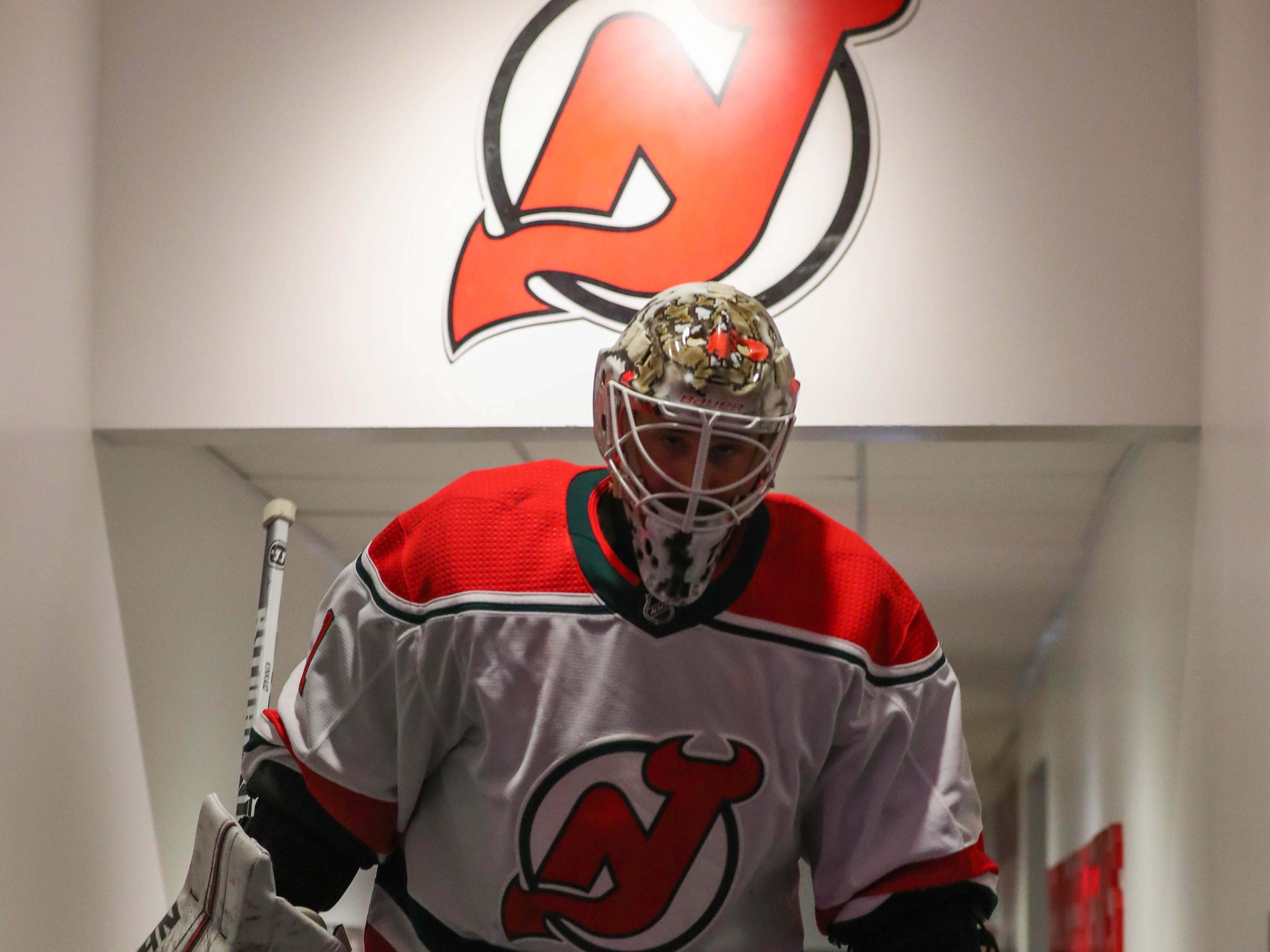 Jan 31, 2019; Newark, NJ, USA; New Jersey Devils goaltender Keith Kinkaid (1) leads the team out of the locker room before the start of their NHL game against the New York Rangers at Prudential Center