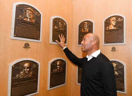 Baseball Hall of Fame inductee Mariano Rivera looks at plaques of original hall members during his orientation tour of the National Baseball Hall of Fame and Museum, Friday, Feb. 1, 2019, in Cooperstown, N.Y. The former New York Yankees closer will be inducted on July 21. (AP Photo/Hans Pennink)