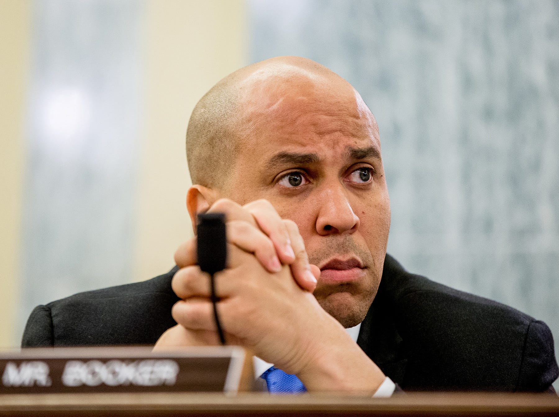 In this June 10, 2015 file photo, Sen. Cory Booker, D-N.J., attends a Senate Commerce, Science and Transportation hearing on Capitol Hill in Washington.   Booker announced his support for the Iran nuclear deal on Thursday, siding with President Barack Obama and bucking home-state pressures.