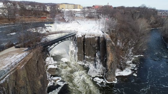 A view of the Paterson Great Falls, with one side frozen due to the extremely cold temperatures, on Friday, Feb. 1, 2019, in Paterson.