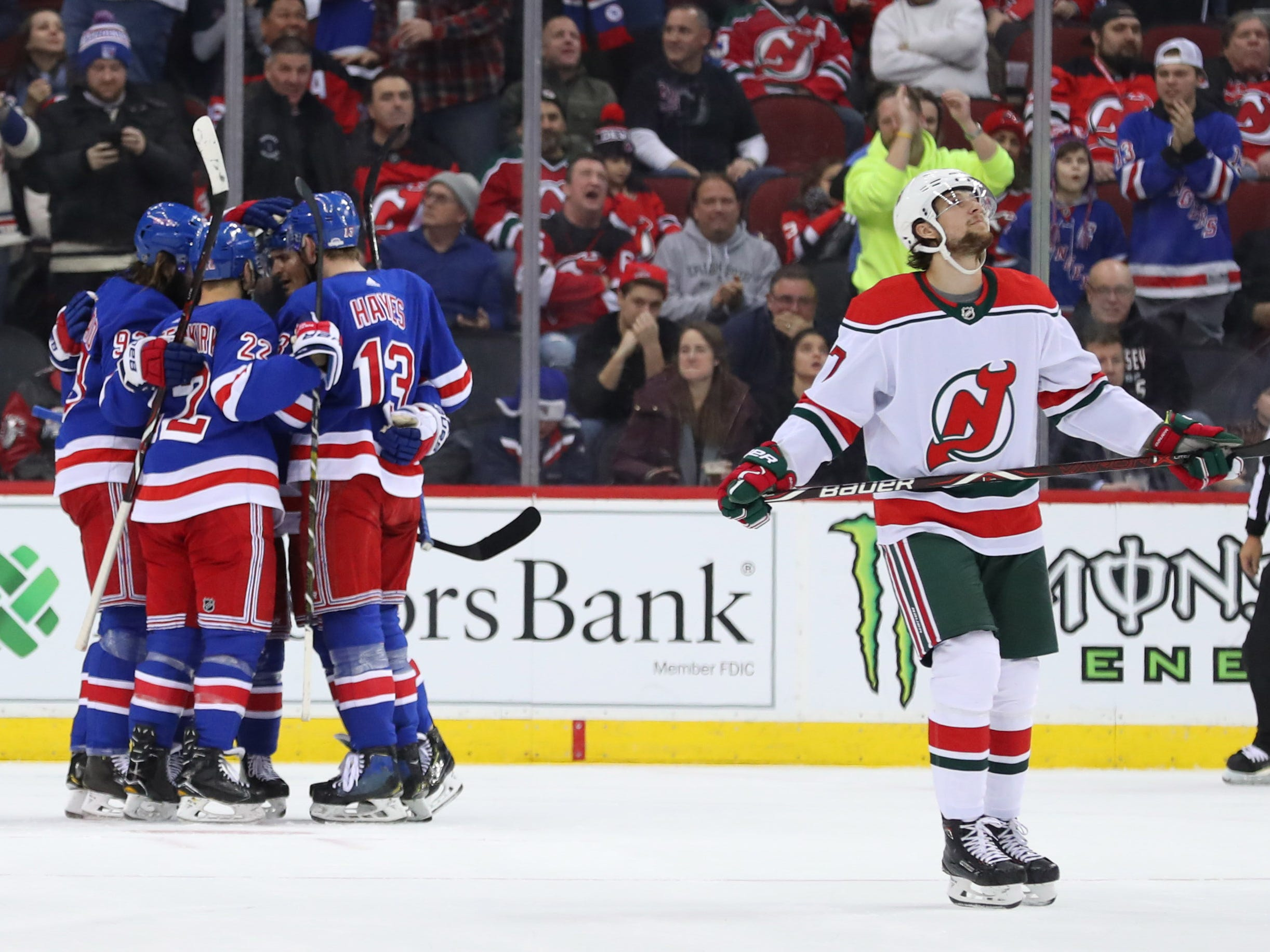 Jan 31, 2019; Newark, NJ, USA; The New York Rangers celebrate a goal by New York Rangers center Mika Zibanejad (93) during the second period of their game against the New Jersey Devils at Prudential Center.