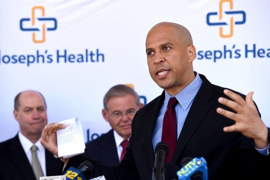 Senators Cory Booker, right, and Bob Menendez, center, have proposed legislation to help states that want to set up their own health-insurance marketplaces to replace the federal healthcare.gov. They say this will help preserve the gains of the Affordable Care Act as the Trump Administration tries to dismantle it.