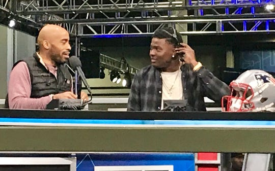 Former Ohio State quarterback Dwayne Haskins, right, talks with former Giants running back Tiki Barber on set at Super Bowl Radio Row in Atlanta on Friday. Haskins, who grew up a Giants fan, said he would not mind if Big Blue were to draft him come April.