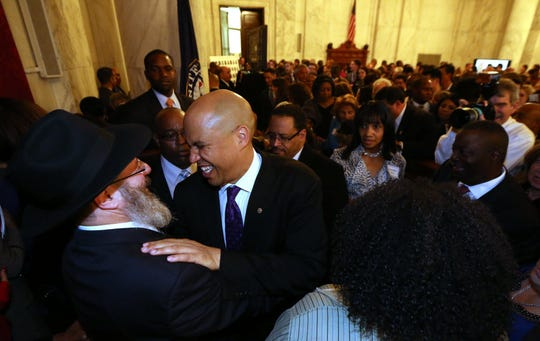 Senator Cory Booker greets Rabbi Levi Block, of the Chabad of Newark, during a reception in the Russell Senate Office Building on Booker's first day as a US Senator in October 2013.