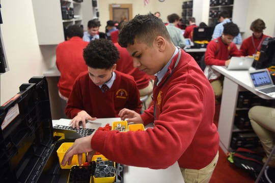 Bergen Catholic High School sophomores Gavin Greene 15 of Orange and Dean Elkeshk of Wood-Ridge work together on a mechanical engineering project in class on Thursday, January 31, 2019.