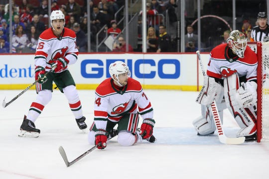 Jan 31, 2019; Newark, NJ, USA; New Jersey Devils defenseman Egor Yakovlev (74) defends from his knees after losing a skate blade during the first period of their game against the New York Rangers at Prudential Center.