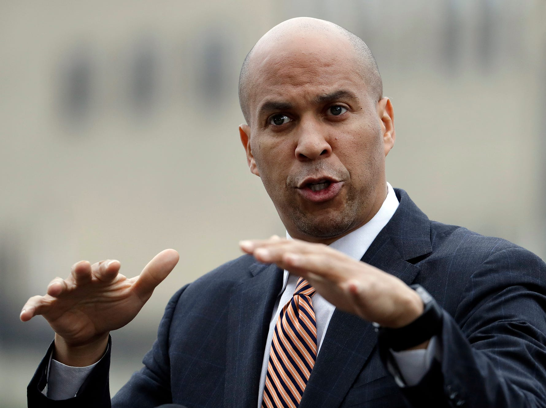 U.S. Sen. Cory Booker speaks during a news conference near the Hoboken station following a train crash, Thursday, Sept. 29, 2016, in Hoboken, N.J. A rush-hour commuter train crashed through a barrier at the busy Hoboken station and lurched across the waiting area Thursday morning, killing one person and injuring more than 100 others in a grisly wreck that revived questions about whether long-delayed automated safety technology could have prevented tragedy.  (AP Photo/Julio Cortez)