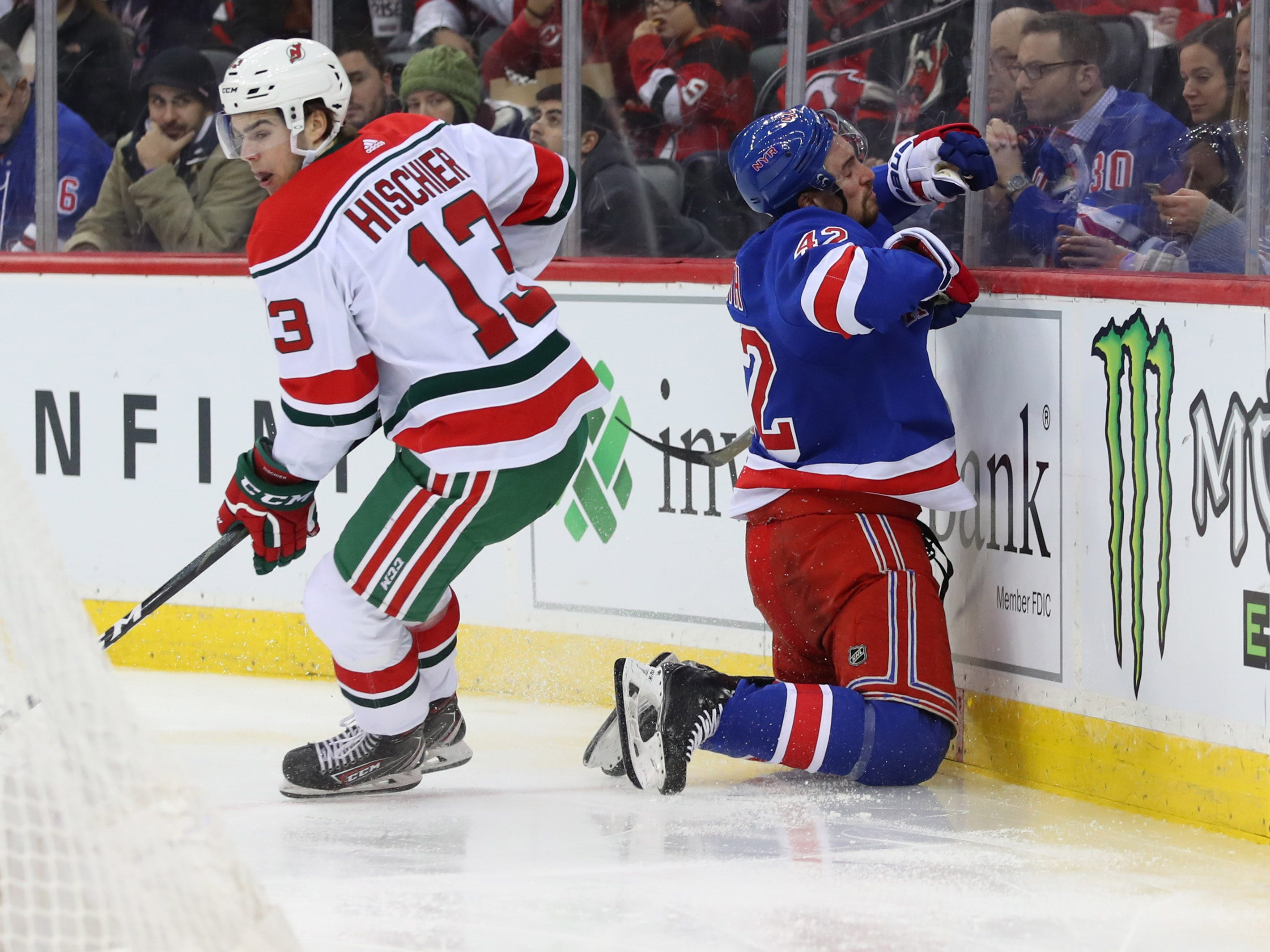 Jan 31, 2019; Newark, NJ, USA; New Jersey Devils center Nico Hischier (13) hits New York Rangers defenseman Brendan Smith (42) during the second period at Prudential Center.