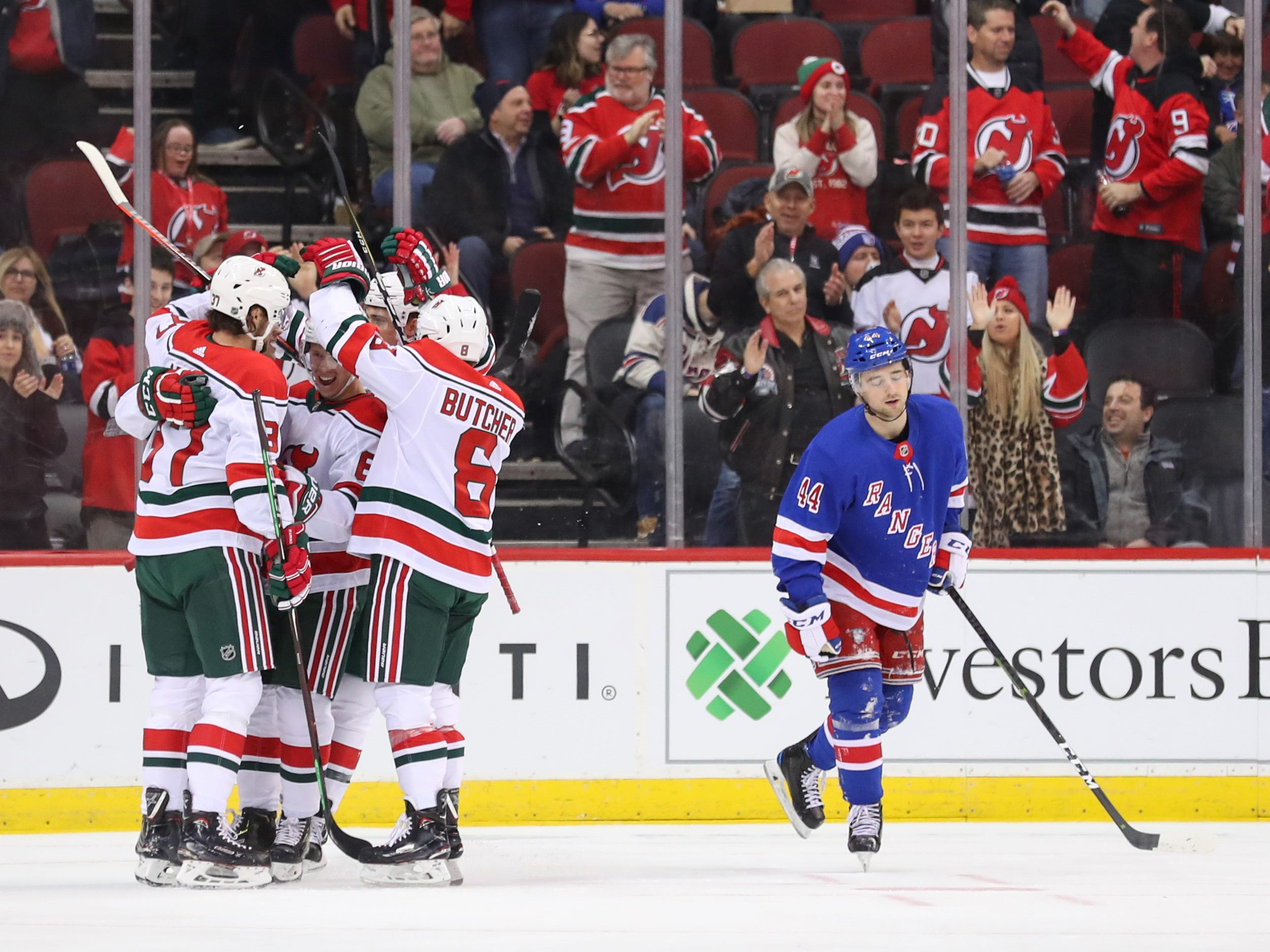 Jan 31, 2019; Newark, NJ, USA; The New Jersey Devils celebrate a goal by New Jersey Devils center Nico Hischier (13) during the first period of their game against the New York Rangers at Prudential Center.