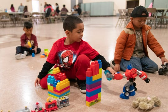 Gadiel, Andres and Marlon play with donated toys provided by a migrant shelter in Doña Ana County.
